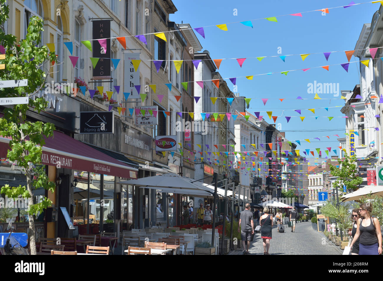 Shopping street in historical part of city decorated during Gentse Feesten in Ghent, Belgium on July 19, 2016 - Stock Image