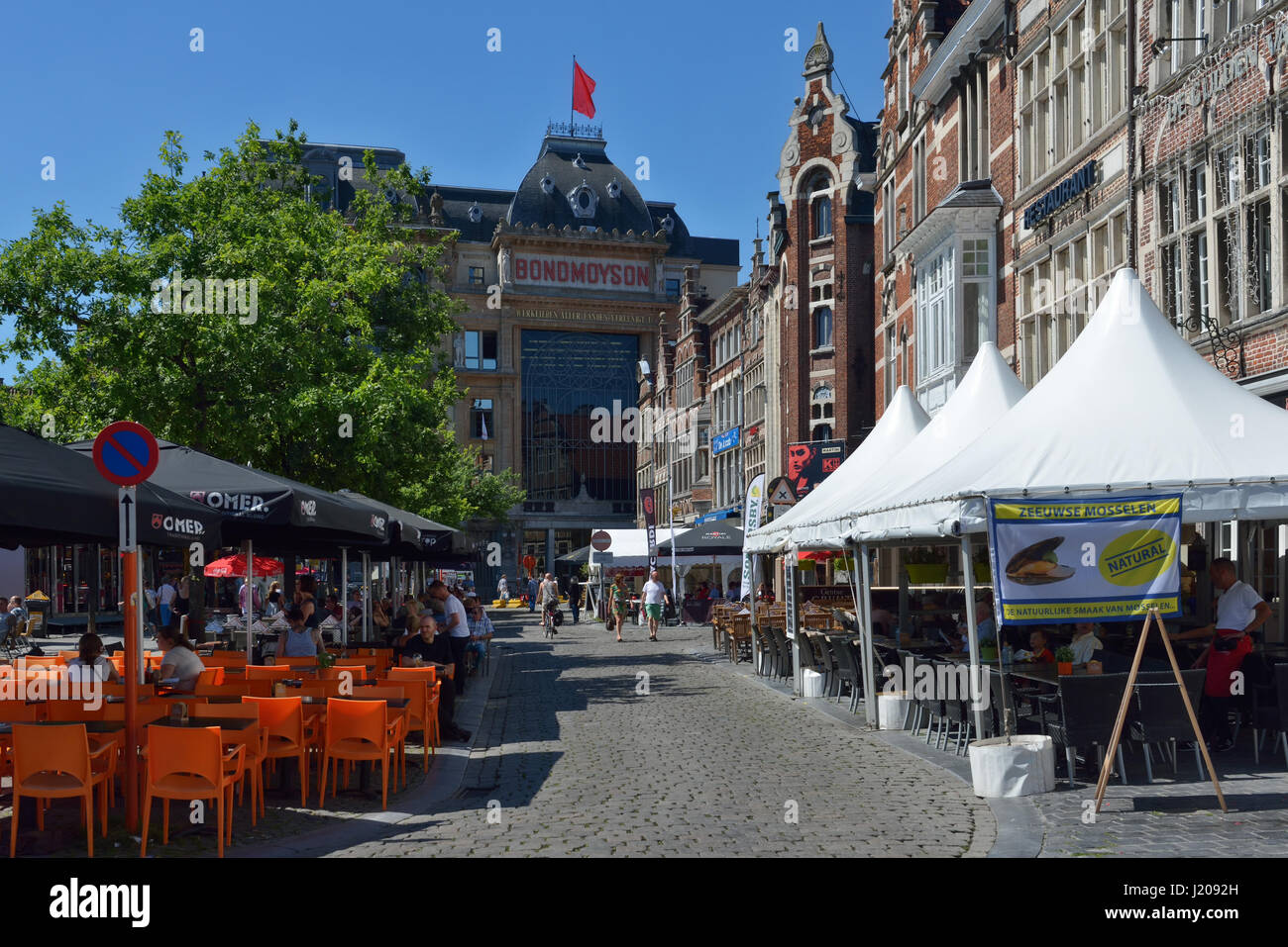 Shopping street in historical part of city during Gentse Feesten in Ghent, Belgium on July 19, 2016 - Stock Image
