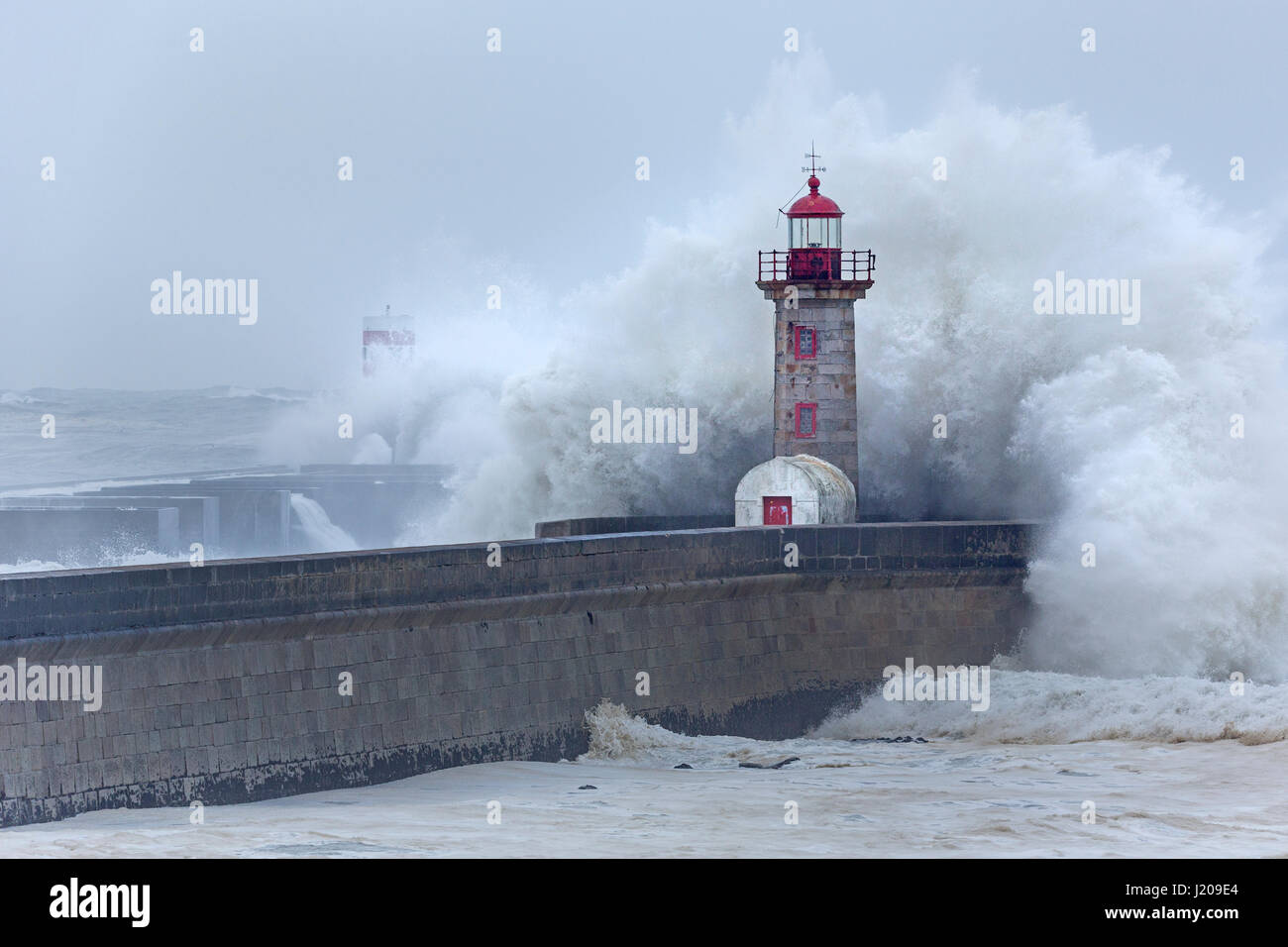 Lighthouse of Porto with storm, Portugal, Europe Stock Photo