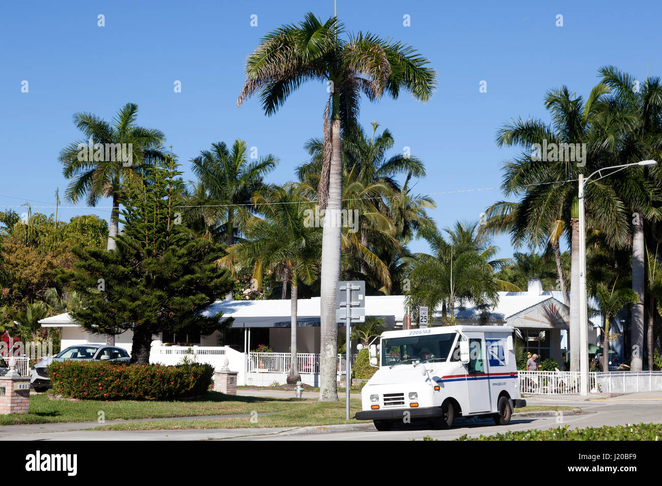 Hollywood, Fl, USA - March 21, 2017: United States Postal Service (USPS) truck delivering in a residential neighborhood - Stock Image