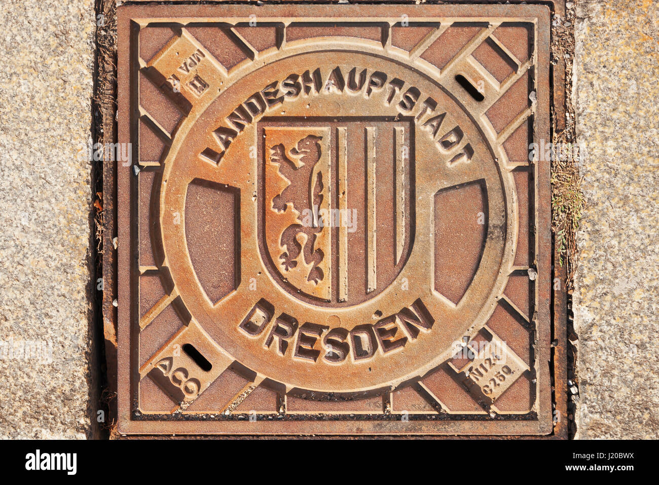 Manhole cover in Dresden with the Coat of arms of Dresden, Saxony, Germany, Europe - Stock Image