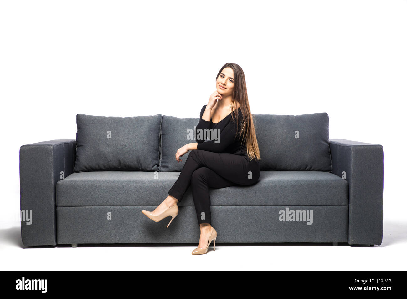 Sensational Woman Sitting On Sofa On White Background Stock Photo Squirreltailoven Fun Painted Chair Ideas Images Squirreltailovenorg