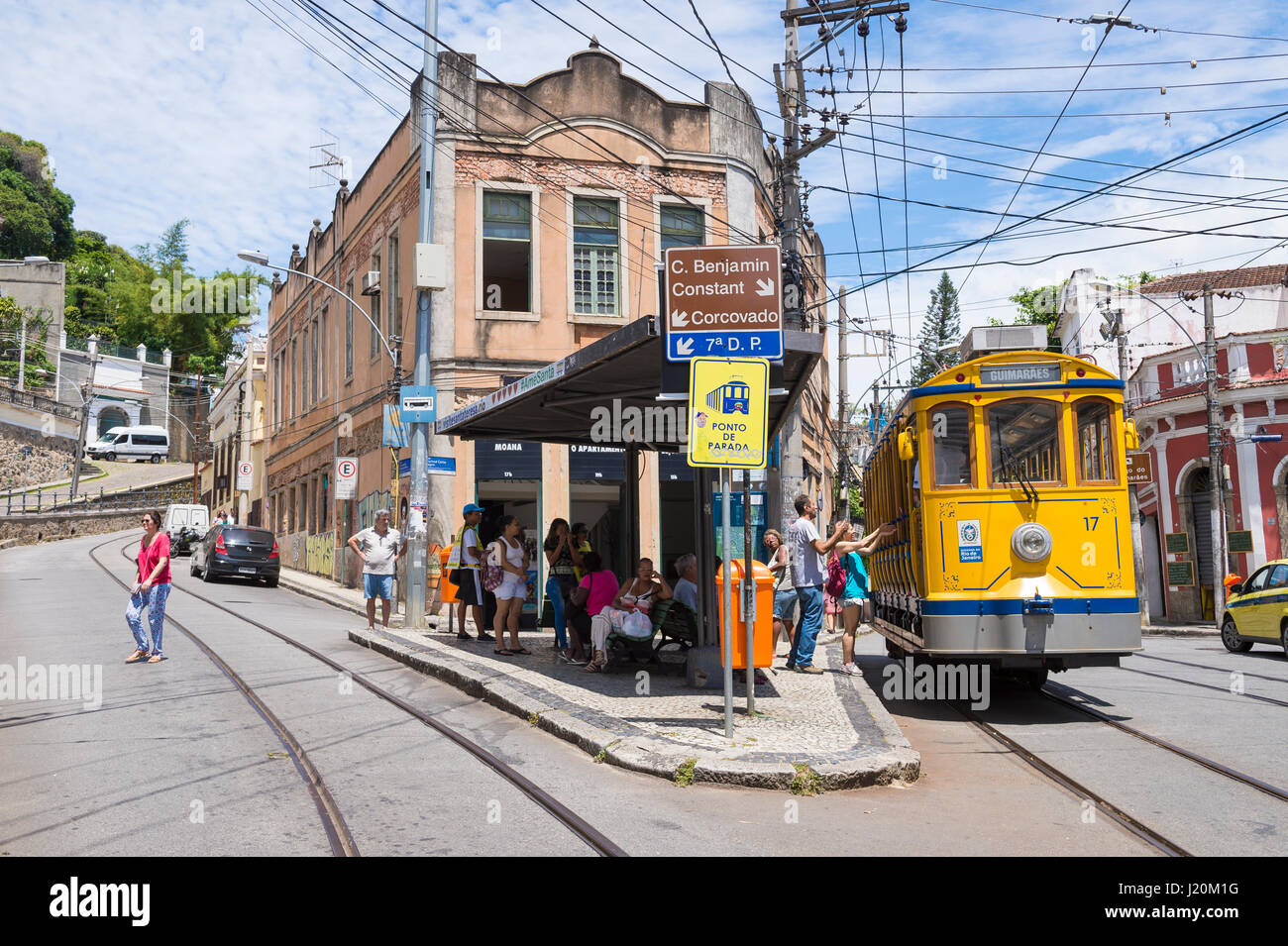 RIO DE JANEIRO - JANUARY 31, 2017: Passengers in Santa Teresa embark on an iconic street car, refurbished after - Stock Image