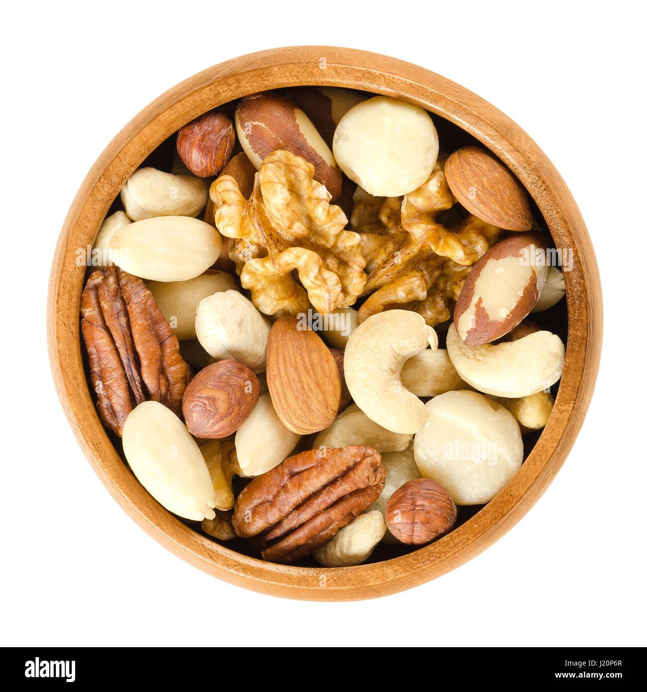 Raw mixed nuts in wooden bowl. Dried walnuts, hazelnuts, almonds, cashews, macadamia, Brazil and pecan nuts. Fancy Stock Photo