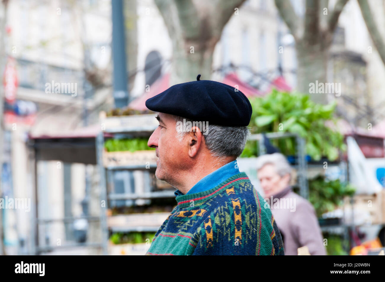 A Frenchman wearing a black beret in Beziers in Southern France. - Stock Image