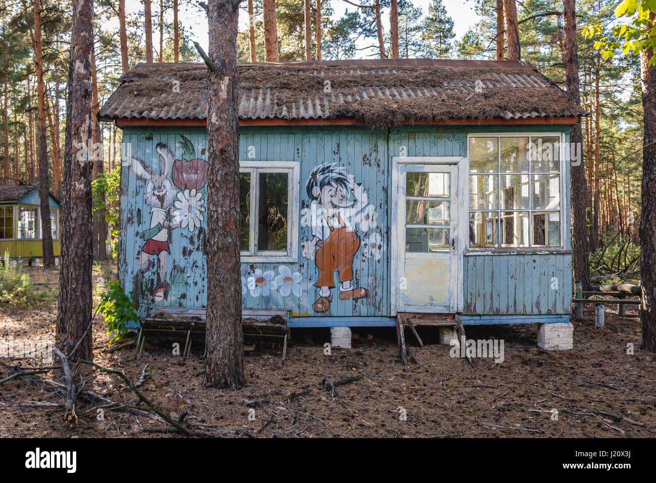 Russian cartoon characters drawed on a summer house in 'Emerald' recreation base in Chernobyl Nuclear Power - Stock Image
