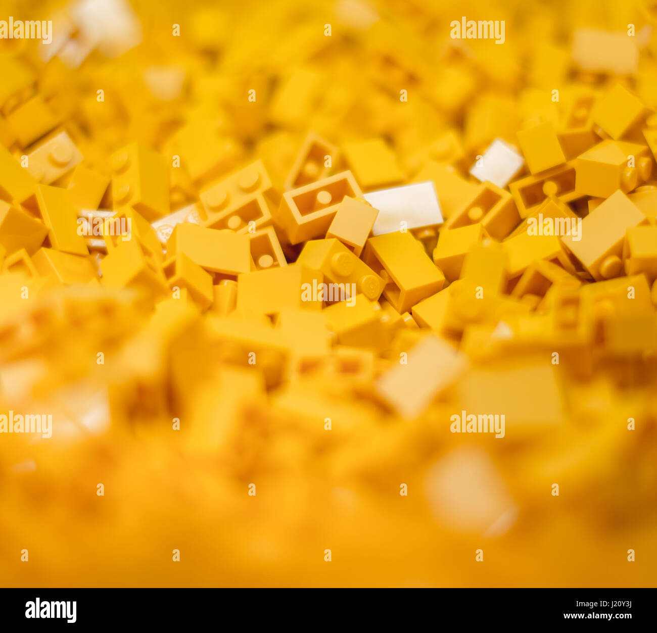yellow Leggo two blocks in a pile about to be shaped into a new magnificent structure by young minds to amaze wondering - Stock Image