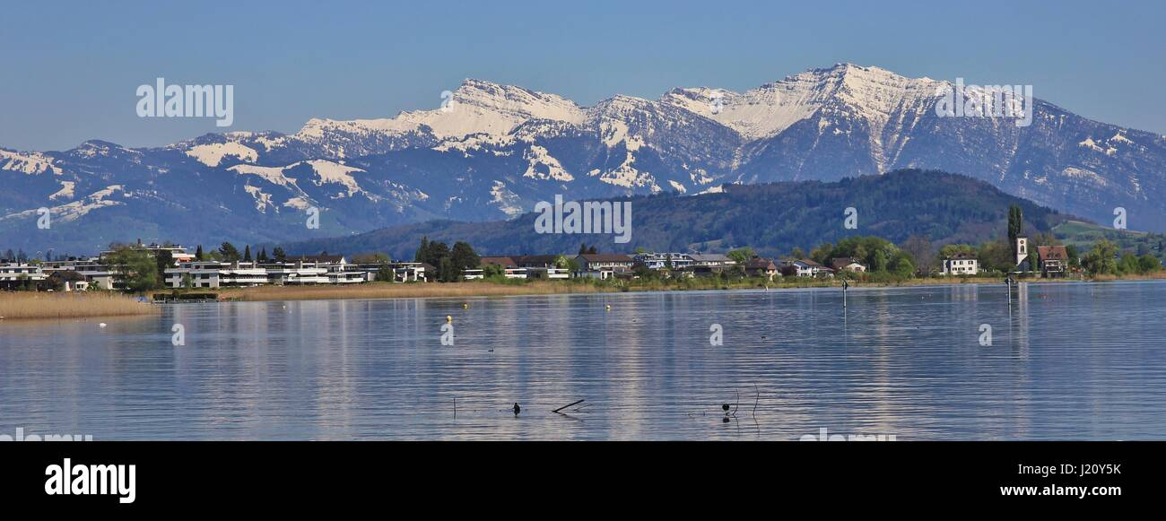 View from Rapperswil towards the snow capped mountain Grosser Speer. - Stock Image