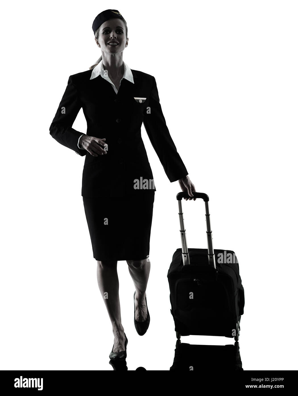 one caucasian Stewardess cabin crew  woman walking isolated on white background in  silhouette - Stock Image
