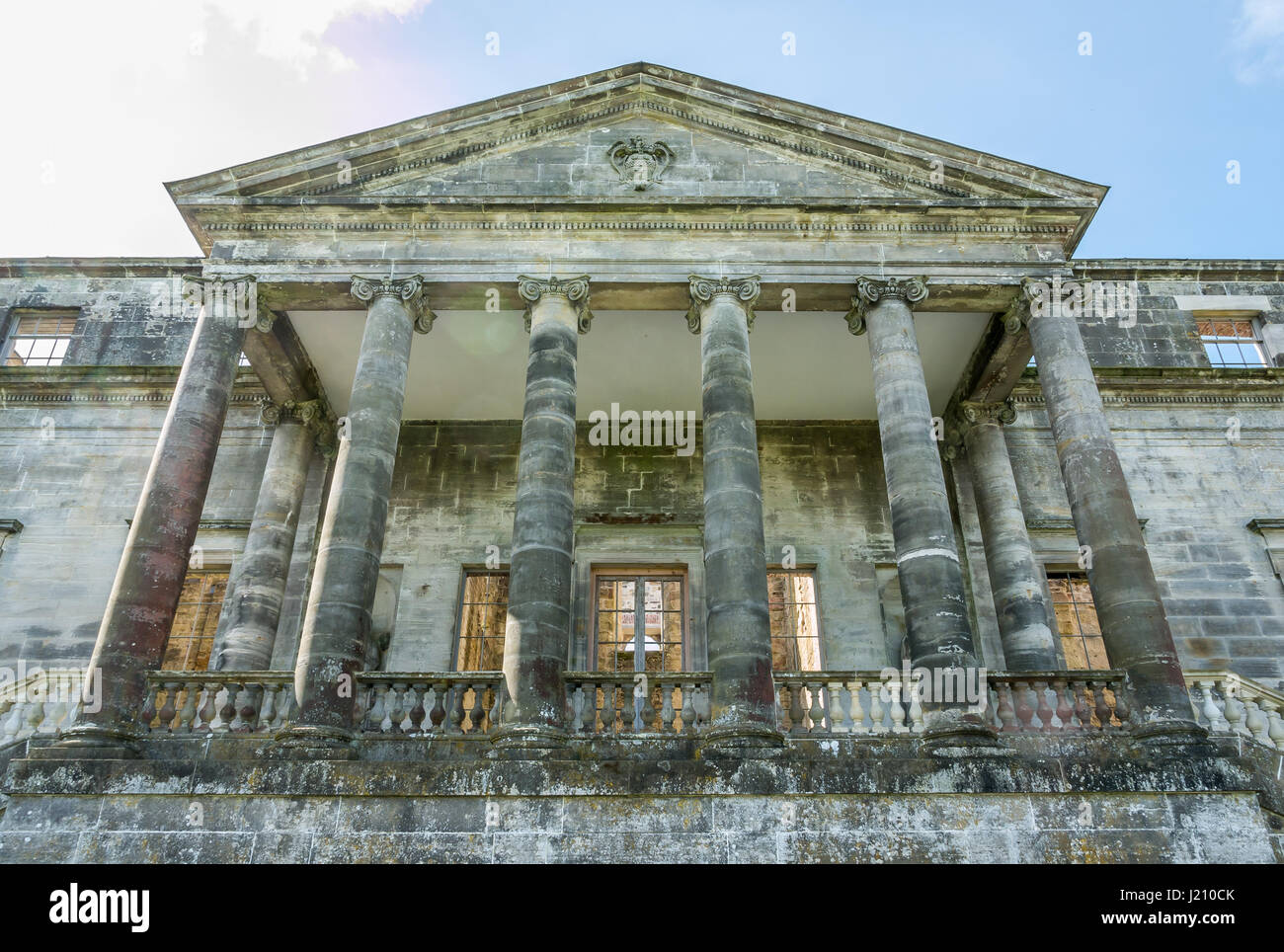 Close up of portico of ruined Palladian mansion, Penicuik House, Penicuik Estate, Midlothian, Scotland, UK, with - Stock Image