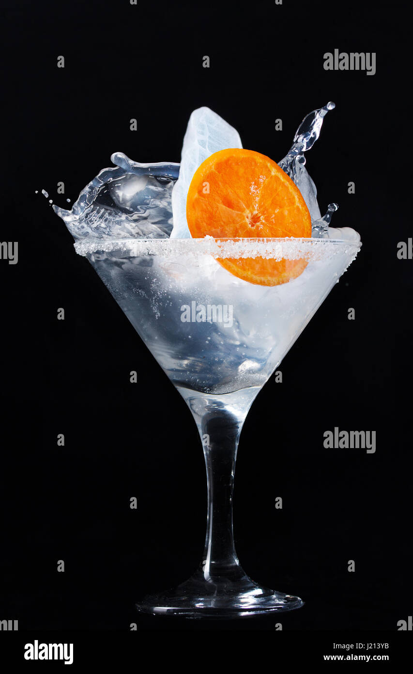 Unusual cocktail with ice in a martini glass - Stock Image