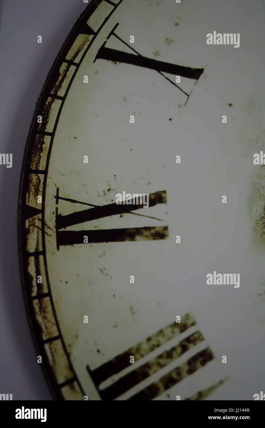 Part of clock with roman numerals close up - Stock Image