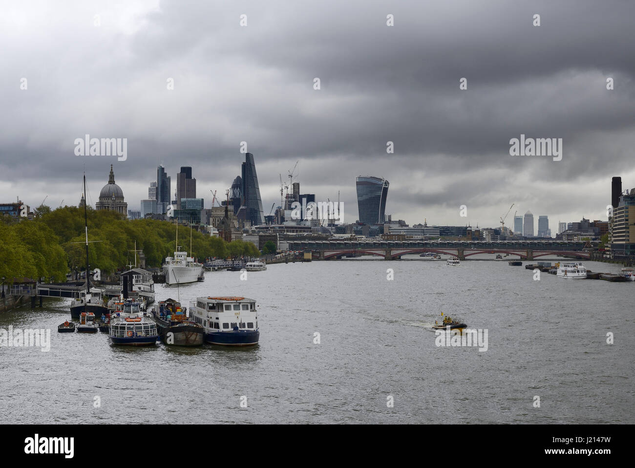 Dark clouds over the financial district of London - Stock Image