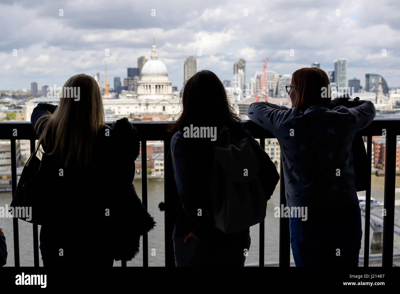 People admiring the view from the Switch House viewing level at Tate Modern London UK - Stock Image