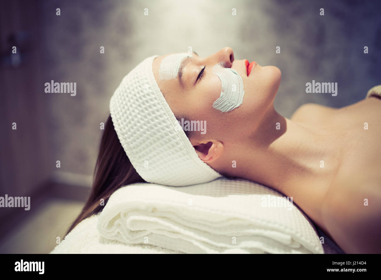 Professional cosmetic and massage treatment at wellbeing saloon Stock Photo