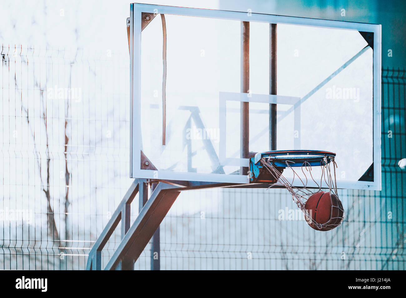 Background image of outdoor playground basketball court - Stock Image