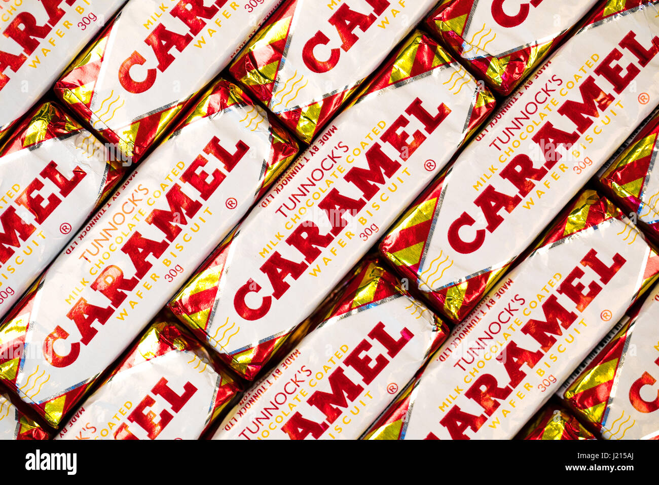 Southampton, UK - 17 March 2017: A background of Tunnock's Caramel Wafer biscuits, a popular chocolate coated snack. - Stock Image