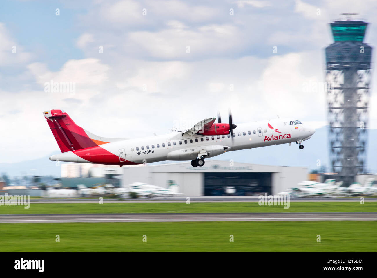 An ATR 72-600 turboprop flown by Colombia's Avianca lifts off from the runway at El Dorado International Airport, - Stock Image