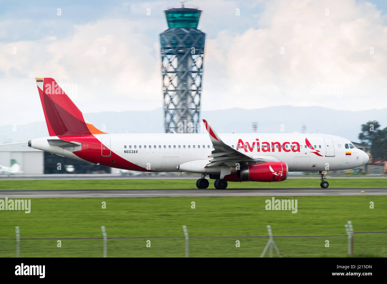 A new Airbus A320 flown by Colombia's Avianca accelerates for takeoff from El Dorado International Airport, - Stock Image