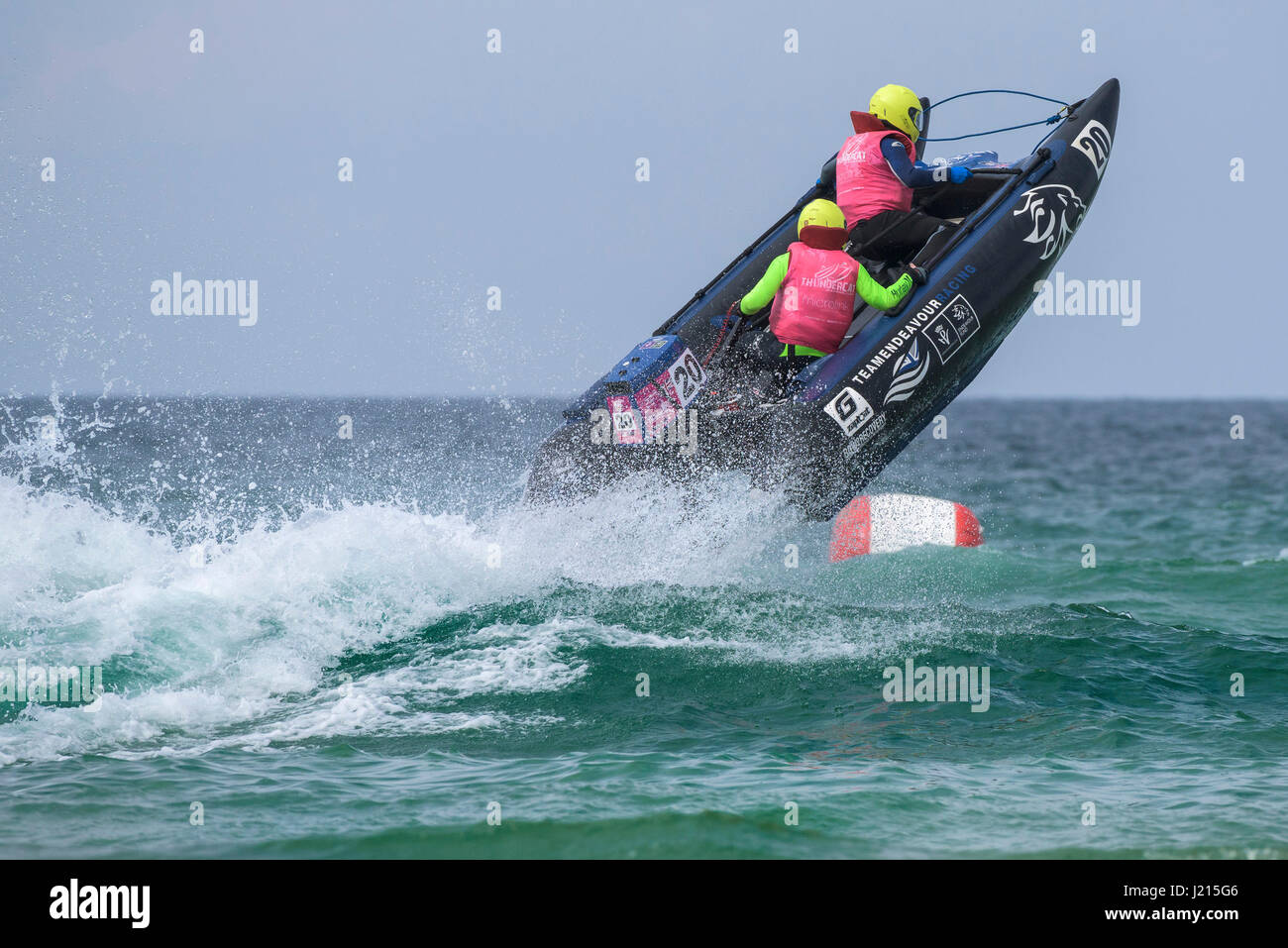 Thundercat Racing Race Sea Spray Spectacular Action Watersport Inflatable boat racing Fistral Beach Newquay Cornwall - Stock Image