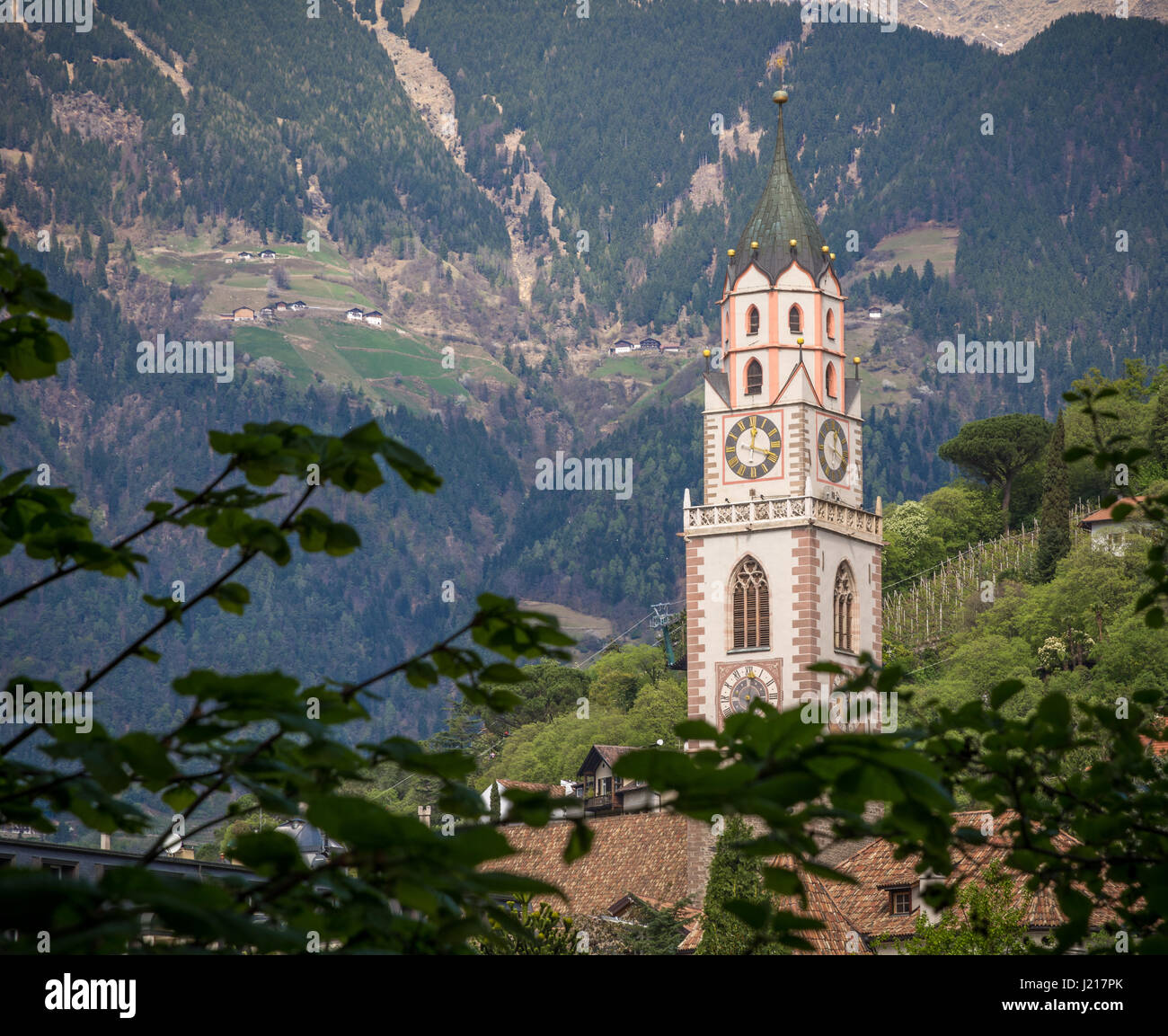Bell Tower of the Cathedral of Merano - Italy / Detail of the bell tower of the Cathedral of St. - Nicholas in Merano, - Stock Image
