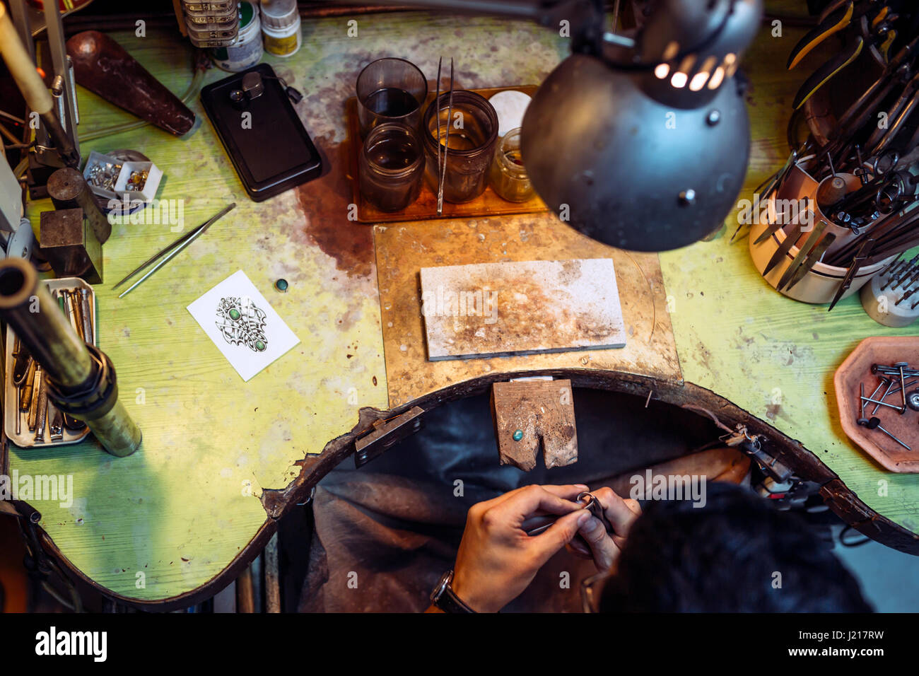 Craftsman working on workbench surrounded by his tools Stock Photo