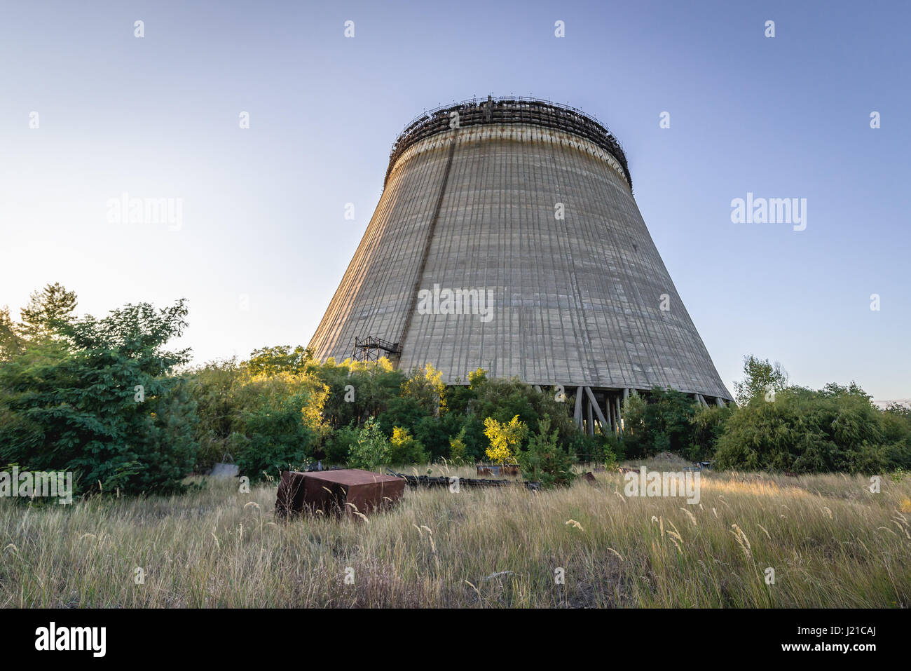Cooling tower of Chernobyl Nuclear Power Plant in Zone of Alienation around the nuclear reactor disaster in Ukraine Stock Photo
