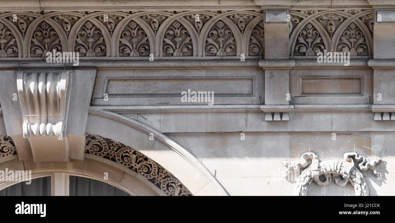elaborate architectural stone detail on the facade of a building in London, England, UK - Stock Image