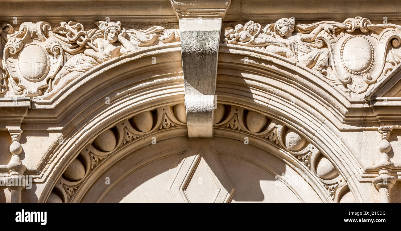 elaborate classical arch above a window made of carved stone, London, England, UK - Stock Image