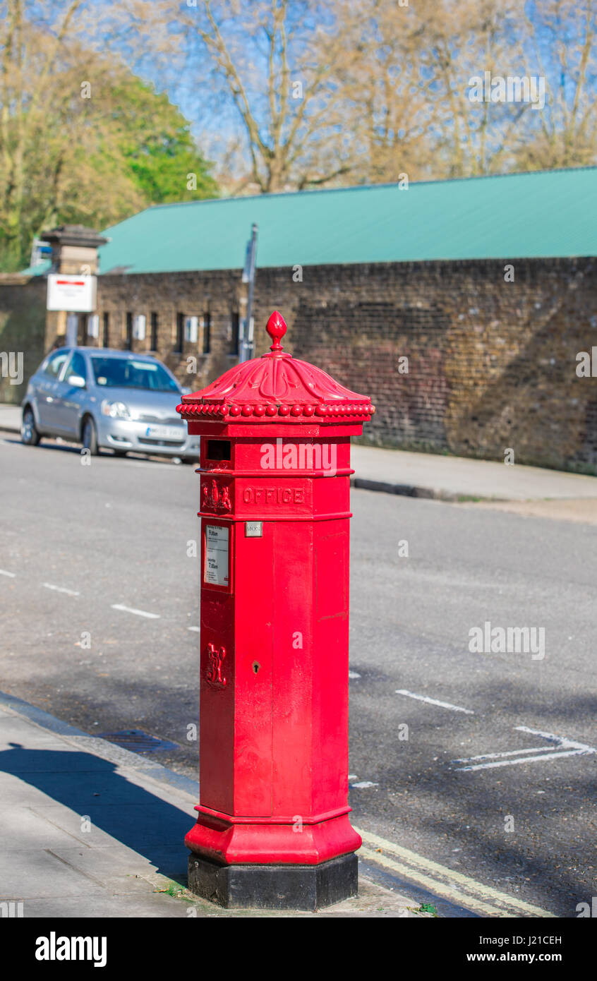 An old red English letter box in London England, UK - Stock Image