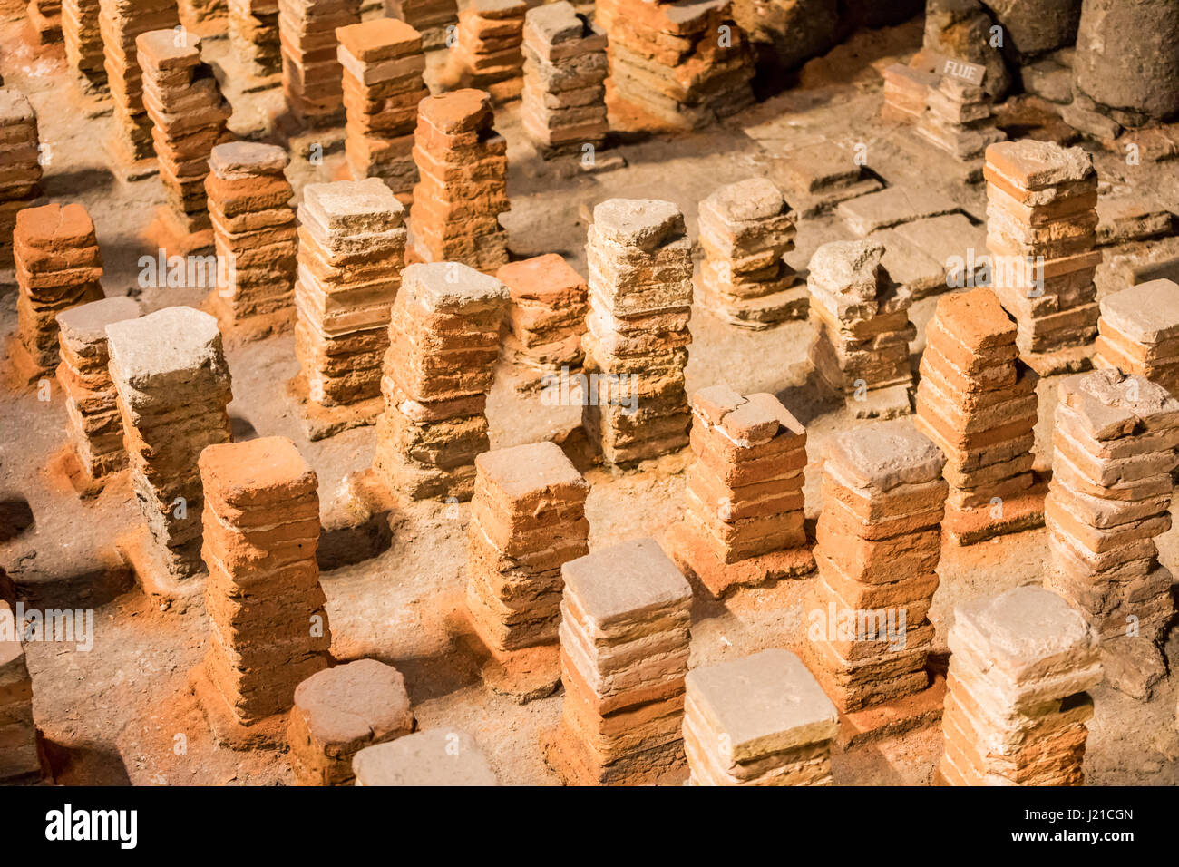 stacks of terra cotta bricks used to support a floor in the roman baths in Bath England, UK - Stock Image