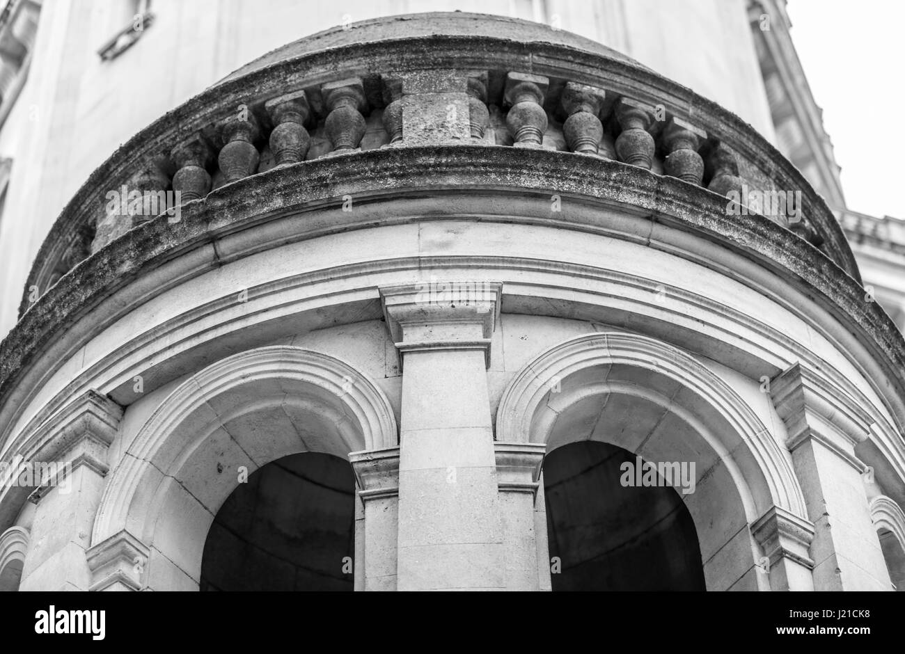 elaborate arches and balustrades in a detail shot of an old London building - Stock Image