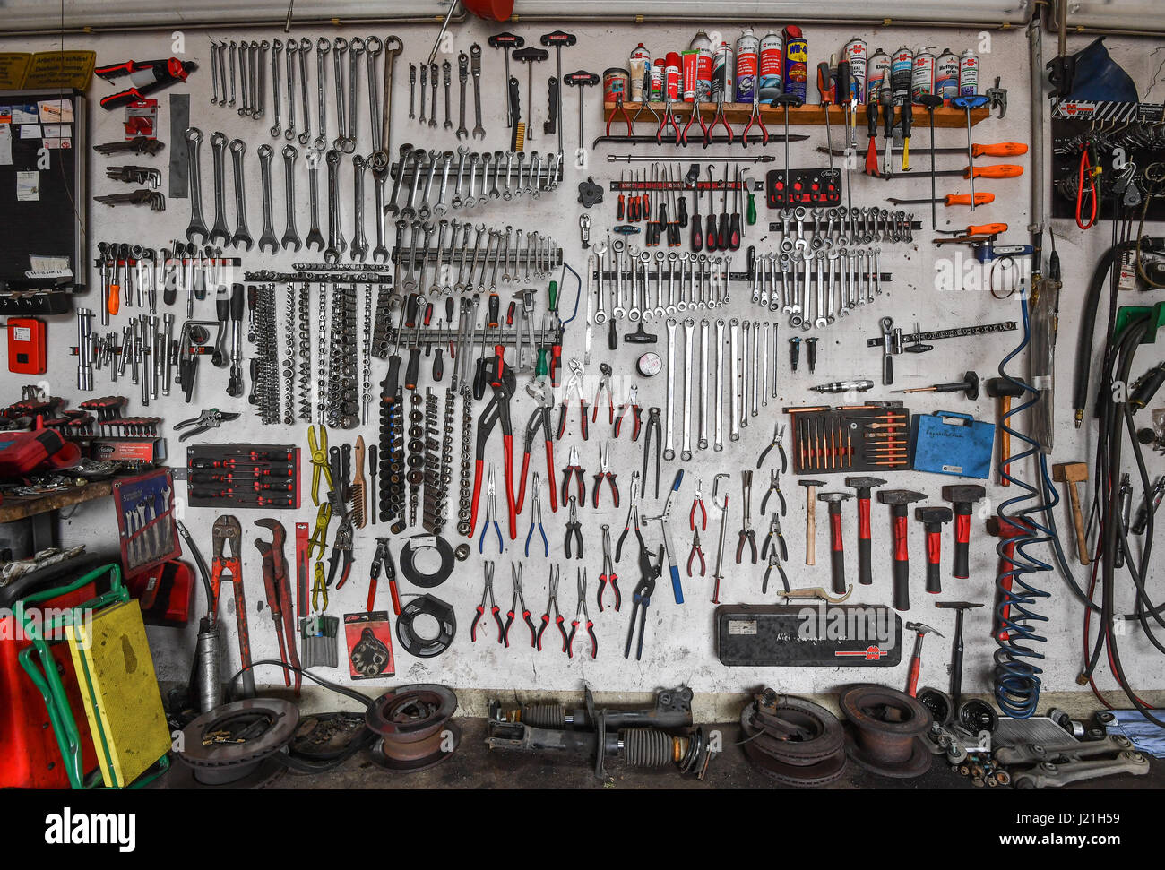 Tools neatly arranged on a wall in a car repair shop in Treplin ...