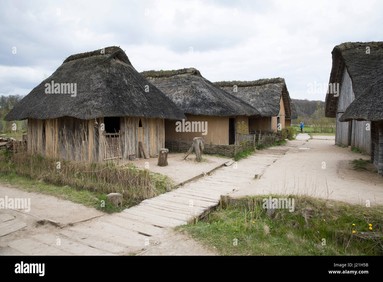 Busdorf, Germany. 19th Apr, 2017. Replicas of Viking houses can be seen on the grounds of the viking village Haithabu - Stock Image