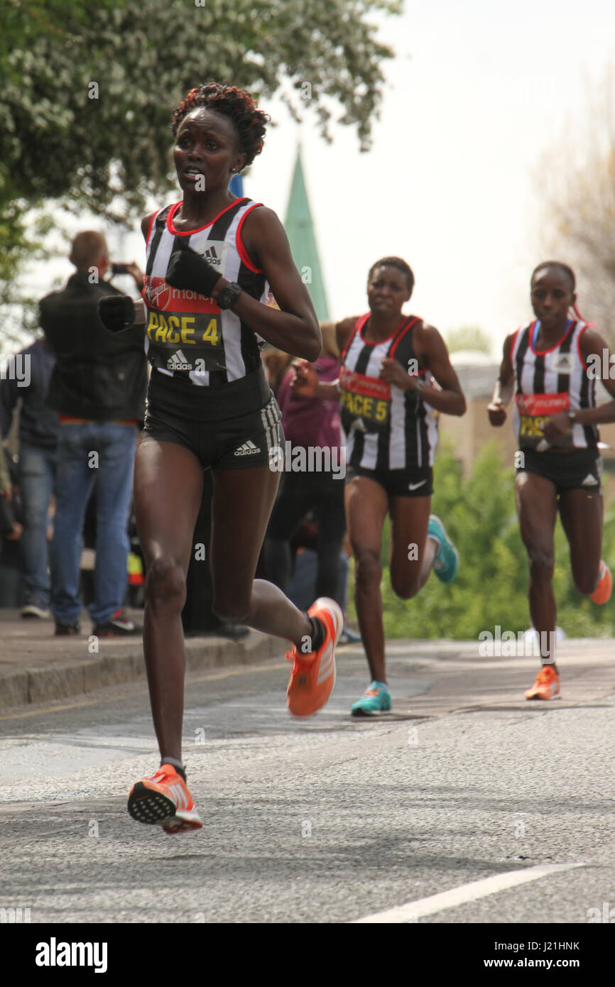 London, UK. 23rd Apr, 2017.  Pace runners race past the 17 mile mark at Madchutte during the 37th London Marathon Stock Photo