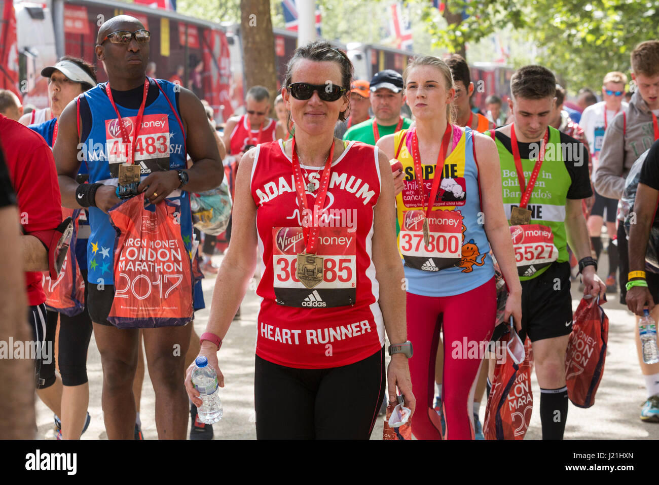 London, UK. 23rd Apr, 2017. Runners finish the 37th London Marathon on the Mall. Credit: Bettina Strenske/Alamy Stock Photo