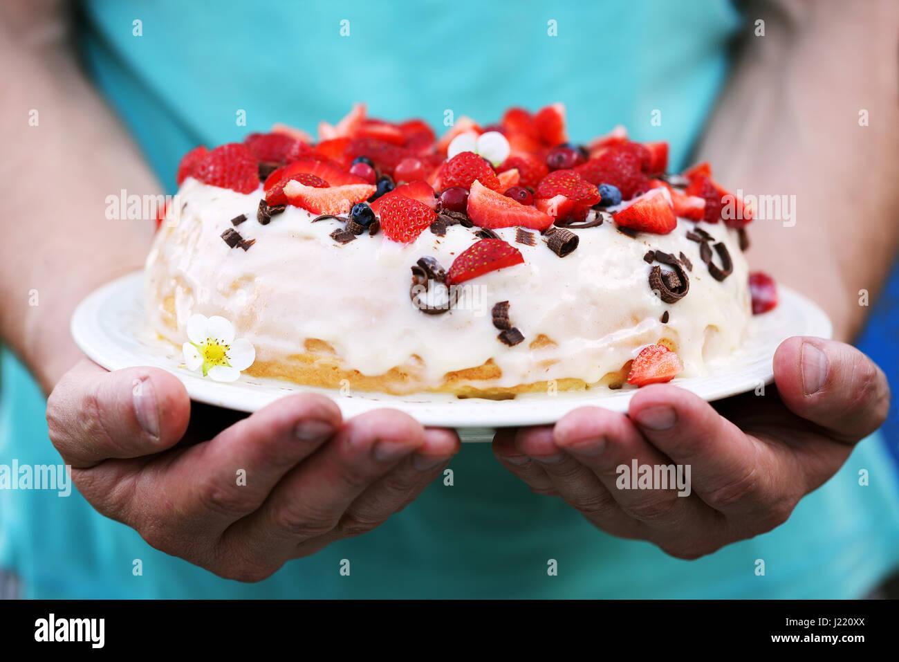 Cake in men's hands - Stock Image