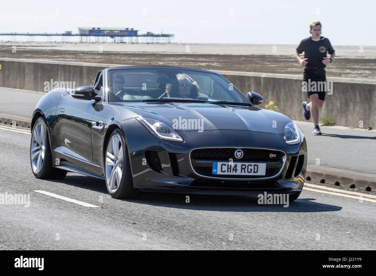 Jaguar F-Type S V8 Auto Vintage Festival and Classic Vehicle Show, with cars driving down the resort seafront and - Stock Image