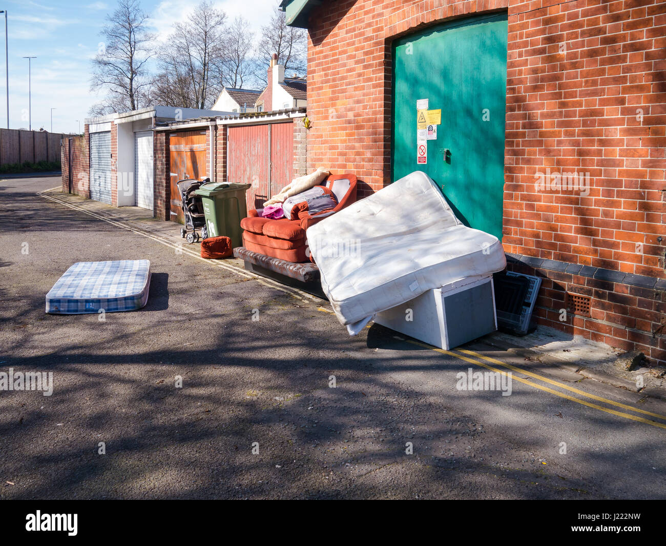 Fly tipping - Household waste and rubbish dumped at a fly tip in an urban area - Stock Image