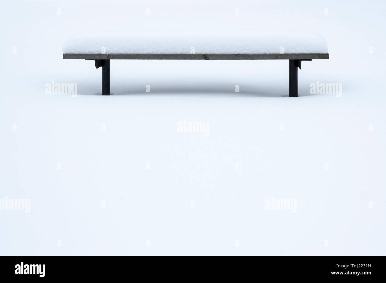 Wood park bench covered in snow, winter, solitude, quietness, meditation, serene, nobody, relaxing, peacefulness, - Stock Image