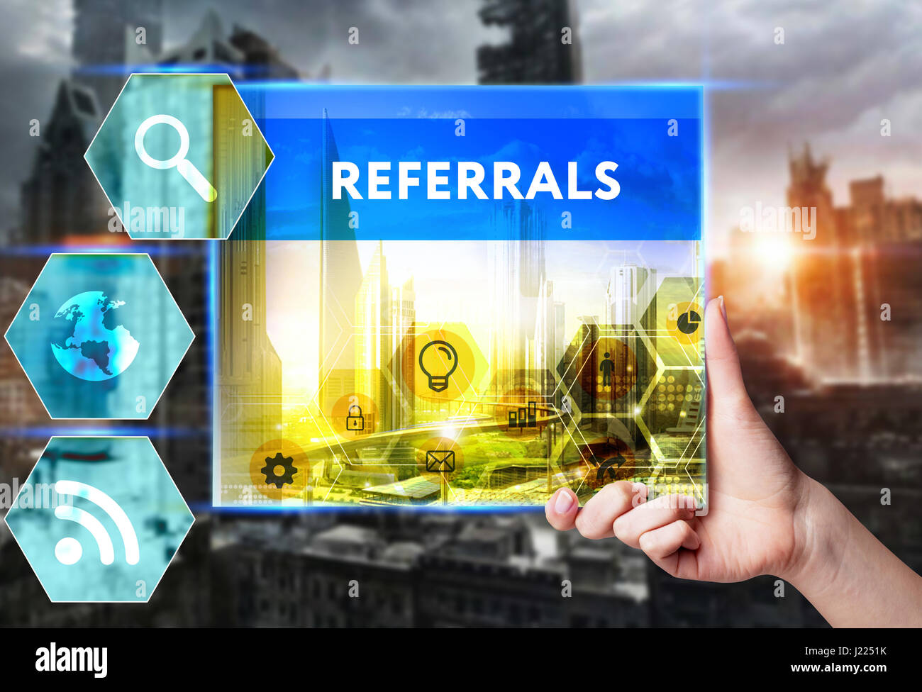 Technology, internet, business and marketing. Young business woman writing word: Referrals Stock Photo