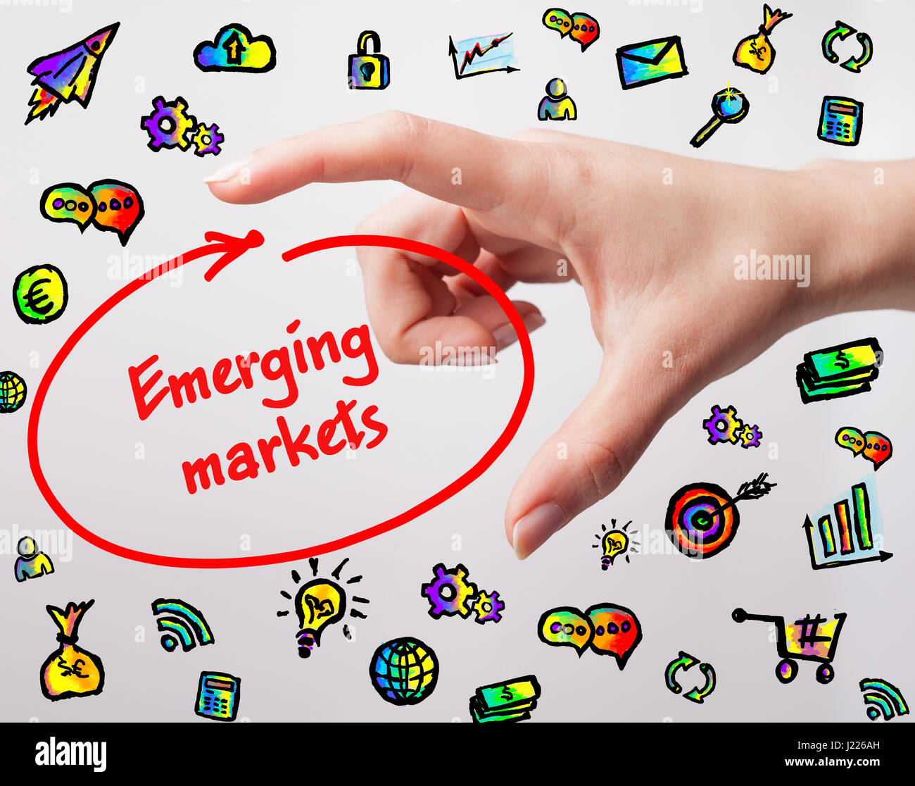 Technology, internet, business and marketing. Young business woman writing word: Emerging markets Stock Photo