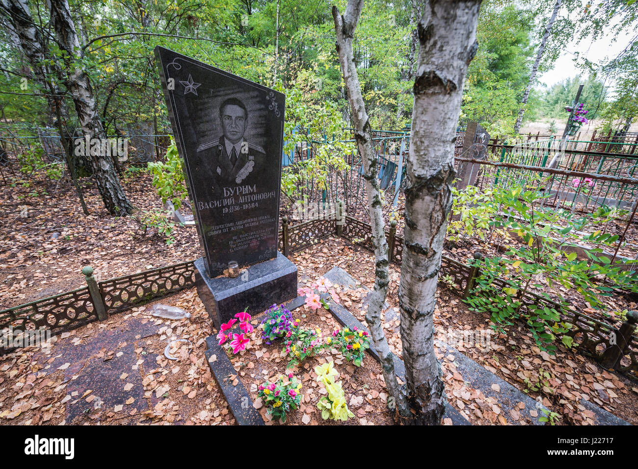 Grave on cemetery in Pripyat ghost city of Chernobyl Nuclear Power Plant Zone of Alienation around nuclear reactor - Stock Image