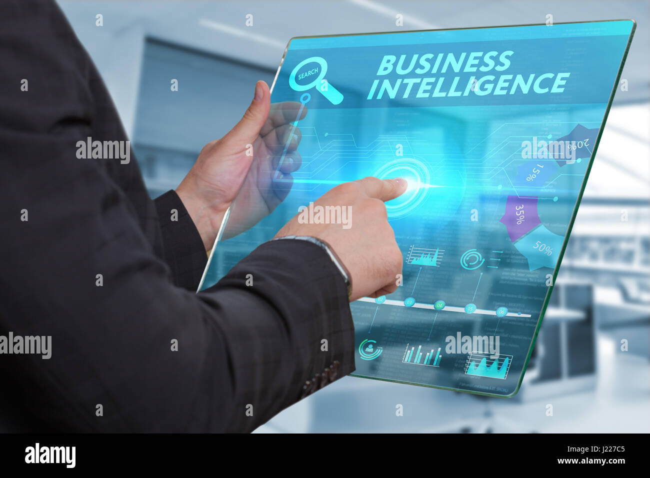 Business, Technology, Internet and network concept. Business man working on the tablet of the future, select on - Stock Image