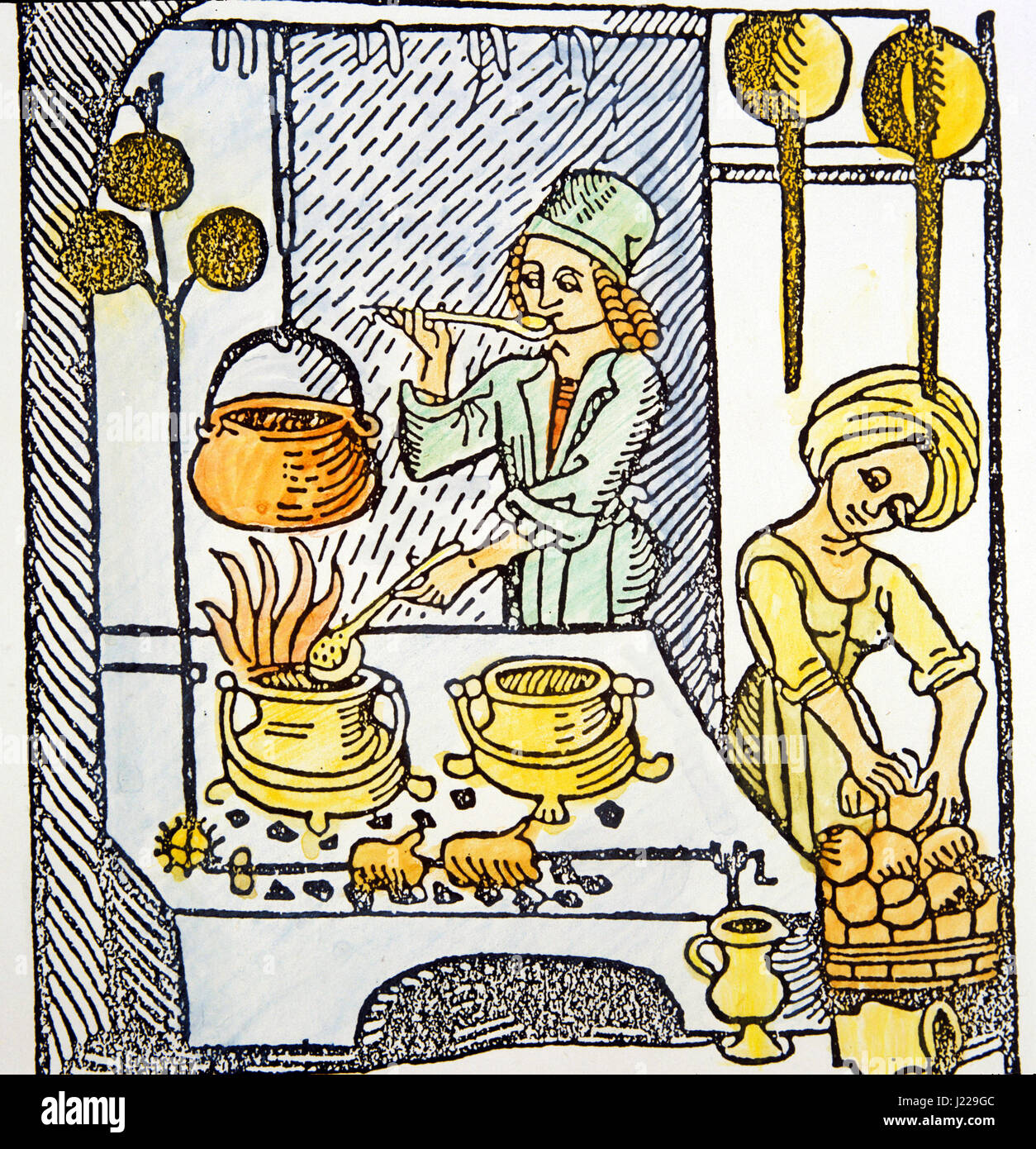 Image No. M15EVA230 15th century engraving. Kitchen scene. Servants cooking, boiling on stove and grilling. - Stock Image
