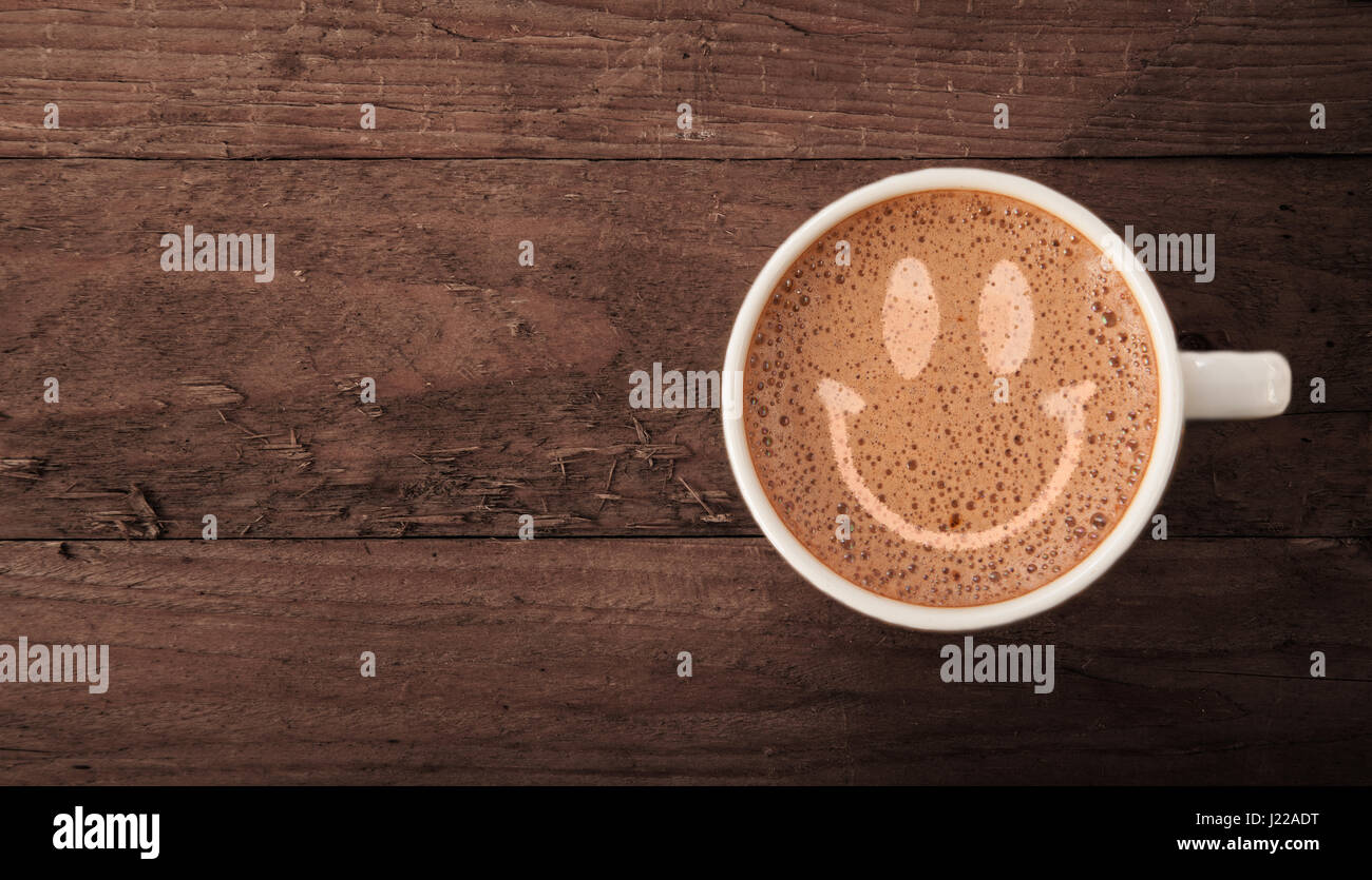 Smiley face on latte froth - Stock Image