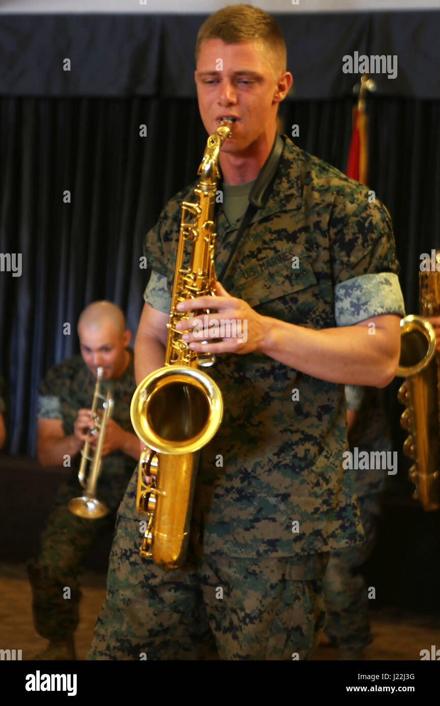Cpl. Allen West, a saxophone player for the 3rd Marine Aircraft Wing band, plays a solo for the volunteers and guests celebrating the Marine Corps Community Services volunteer appreciation ceremony at Marine Corps Air Station Miramar, April 19. This year's volunteer service celebration recognized the selfless acts of over 100 volunteers from around MCAS Miramar and the surrounding community. (Marine Corps photo by Sgt. David Bickel/Released) Stock Photo