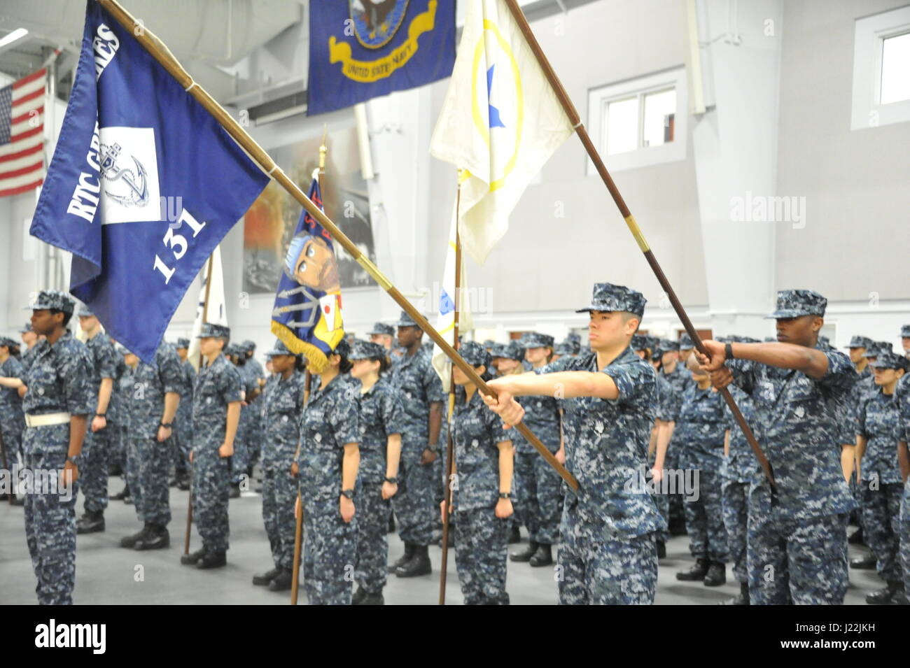 170419-N-CM124-007  GREAT LAKES, Il. (April 19, 2017)  Recruits rehearse their pass-in-review graduation ceremony - Stock Image