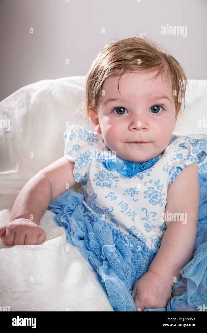 Portrait of a four month old baby girl - Stock Image