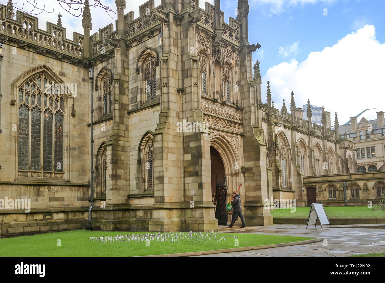 Exterior facade view of the famous medieval building of the cathedral of the city of Manchester in United Kingdom, - Stock Image